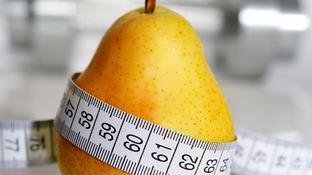 health Measuring tape around a pear